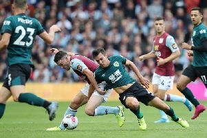 Jack Cork suffered a shoulder injury in this challenge with John McGinn