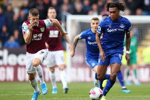 Burnley's Johann Berg Gudmundsson is in hot pursuit of Everton's Alex Iwobi at Turf Moor