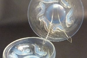 A Lalique Ondines opalescent bowl and platter.
