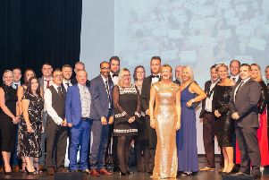 Pendlesides Christina Cope, centre right, with representatives of the Corporate Challenge businesses. Photo: Andy Ford