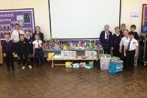 The pupils and the donated goods