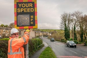 Coun. Ivor Emo installing the sign. Pic: Lewis Welch
