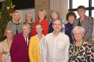Graham Liver with the Ribble Valley Macmillan Chairman Susan Fillary and committee members.