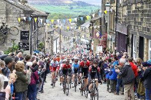 Team INEOS lead the peloton in Haworth, during stage four of the Tour de Yorkshire on Sunday May 5, 2019. Picture: Martin Rickett/PA Wire
