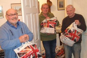 Burnley Lions (from left to right) Peter Ashkettle, David Pascoe and Brian Hartley with some of the gift bags for the town's young carers.