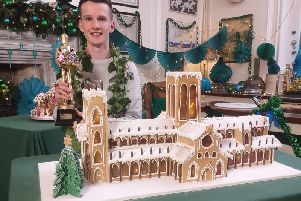 Stephen Harrison with his stunning gingerbread creation of York Minster