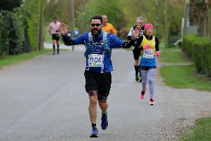 Jonathan Chapman on his way to victory in Striders annual Phil Rose 10K handicap race.