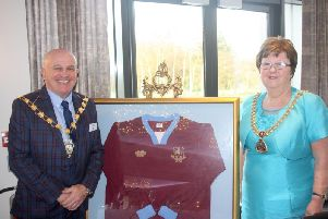 Showmen's Guild Lancashire Section Chairman Albert Hill with the Mayor of Burnley, Councillor Anne Kelly, pictured with a Lancashire Showmen's Football Club (the team happens to play in the same claret and blue colours as Burnley FC)