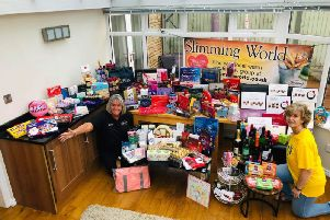 Caroline Griffiths (right) and Janet Barnes, who is a consultant for the Barrowford Slimming World group, with the goodies ready to be taken to Pendleside Hospice.