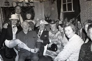 Love Thy Neighbour star Paul Luty, who played barman Nobby, is pictured with pensioners at the Lane Ends pub Christmas party. Also pictured are comedian Walter Horam and landlady Liz Curran