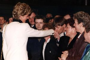 Leyland DAF area manager Gerry Smith, 46, leans forward to kiss Diana, Princess of Wales, on the hand during her visit to Lancashire