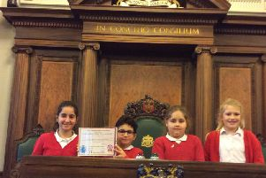 Pupils from Earby Springfield Primary School with their special award for being so welcoming.