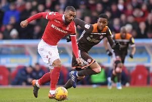 NOTTINGHAM, ENGLAND - FEBRUARY 09: Lewis Grabban of Nottingham Forest skips past the challenge of Ezri Konsa of Brentford during the Sky Bet Championship match between Nottingham Forest and  Brentford at City Ground on February 09, 2019 in Nottingham, England. (Photo by Laurence Griffiths/Getty Images)