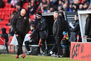 Uwe Rosler looks glum at Doncaster Rovers in what was to be his last game as Fleetwood Town head coach
