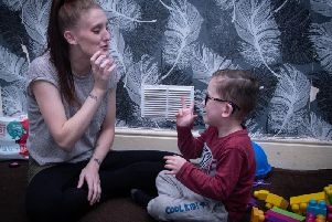 Samantha and Daniel communicating through sign language, which the determined mum plans to teach in a workshop at Costa Coffee. (s)