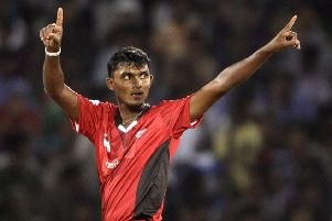 Ruhuna's bowler Alankara Asanka Silva reacts after taking the wicket of Leicestershire player Wayne White during the Champion League Twenty20 qualifying cricket match between Ruhuna and Leicestershire in Hyderabad, India, Wednesday, Sept. 21, 2011. (AP Photo/Mahesh Kumar A.)