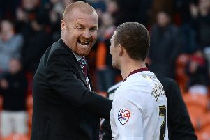 Burnley manager Sean Dyche (left) celebrates with Kieran Trippier after his teams 1-0 win against Blackpool, during the Sky Bet Championship match at Bloomfield Road, Blackpool. PRESS ASSOCIATION Photo. Picture date: Friday April 18, 2014. See PA Story SOCCER Blackpool. Photo credit should read: Martin Rickett/PA Wire. RESTRICTIONS: Editorial use only. Maximum 45 images during a match. No video emulation or promotion as 'live'. No use in games, competitions, merchandise, betting or single club/player services. No use with unofficial audio, video, data, fixtures or club/league logos.