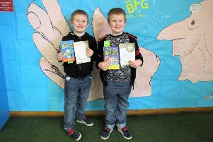 Twins Freddie and Frankie Knight (five)have both read and reviewed 50 books to complete the Lancashire Reading Trail together at Nelson Library. (s)