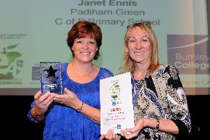 Burnley College Assistant Principal Alison Cameron-Brandwood (right) presents Mrs Ennis with her Inspirational Teacher award in 2016
