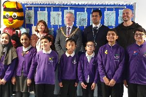 Pupils at Barden Primary School celebrating British Values Day with Burnley Football Club mascot Bertie Bee, MP Julie Cooper, town mayor Coun. Charlie Briggs, chair of governors Afrasiab Anwar MBE and published poet Matt Goodfellow. (s)
