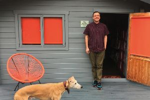 Versatile creative art director Andy Cole outside his shed in Knaresborough with his dog Toby.