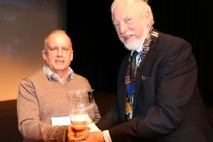 Mike Breeze (right), chairman of Burnley Film-makers, presenting an award at the society's 43rd film festival. (s)