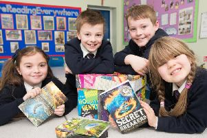 Lola Whittaker, Lewis Sudall, Rory Wilcock and Freya Gracey, students at St Augustine's RC Primary School in Burnley, each scored 100% in a book quiz.