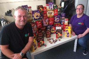 Anthony and Starvin' Marvin assistant manager Carlene Jackson pictured with some of the Easter eggs donated to their appeal.