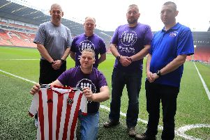 A group of former soldiers set off on their charity challenge to go around 96 sports grounds in 96 hours. Pictured are Chris Nicholson, Tom Hardie, Bear Randell-Eyre, Gary Allen and Neil Wold leaving Bramall Lane. Picture: Chris Etchells