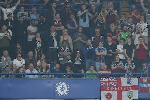 Clarets fans cheer on the lads away at Stamford Bridge. Photo: Rob Newell/CameraSport