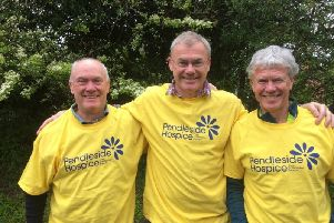 Steve Ennis (centre) with his brothers, John (left) and Anthony before they set off on their mammoth kayak journey in memory of  their brother Mick.
