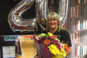 Angela Fielden is celebrating 20 years at a Slimming World consultant.