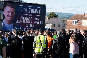 Crowds gathered last night to listen to Tommy Robinson, who is due to stand in the European elections tomorrow, when he arrived in Burnley.