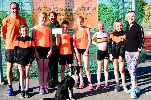Pictured are several of the Clayton Juniors with coaches Marion Wilkinson and Jason Pier, alongside Annette McGowan-Doe, Asda Burnleys Community Co-ordinator.