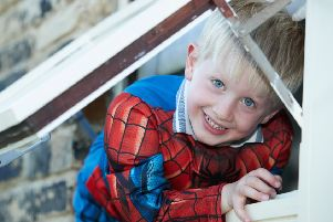 Young Isaac Barraclough crawled through the window of a house to open door after his aunty collapsed.