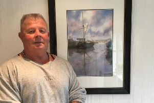 John Parker, a former professional bodybuilder, with one of his stunning watercolour paintings, which are inspired by nature and the Lancashire landscape. (s)