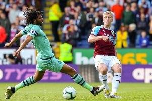 Burnley's Ben Mee plays a ball past Arsenal's Mohamed Elneny''Photographer Alex Dodd/CameraSport''The Premier League - Burnley v Arsenal - Sunday 12th May 2019 - Turf Moor - Burnley''World Copyright � 2019 CameraSport. All rights reserved. 43 Linden Ave. Countesthorpe. Leicester. England. LE8 5PG - Tel: +44 (0) 116 277 4147 - admin@camerasport.com - www.camerasport.com