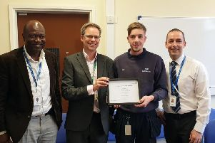 Director of Service Improvement Martin Hodgson (centre left) presents Sean with'his East Lancashire Hospitals Employee of the Month certificate, flanked by colleagues Andrew Appiah and Larry Cottey