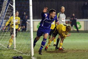 Matlock Town striker Ross Hannah turns away in delight after scoring the equalising goal in last nights 2-1 win over North Ferriby United.