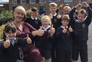 Rosewood Primary School pupils celebrate a 'good' Ofsted report with headteacher Nerys Ditchburn-Hughes