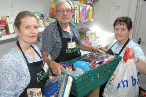 NAWN 1807241AM1 Wetherby Food Bank. Project manager Claire Fleetwood with  team leader John Borman and volunteer Sheila Hollaway.   (1807241AM1)