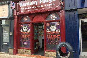 Popular Burnley town centre shop Barnaby Fudge was one of two town centre shops targeted by raiders this week who made off with cigarettes and cash.