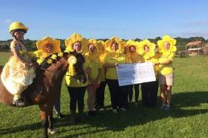 Ulnes Walton Bridleways Association raised 1,900 for St Catherine's Hospice by holding Sue's Spring Ride, in memory of Sue Taylor-Green, who died of cancer. Her niece, Jessica Berry, 7, is picture on the horse