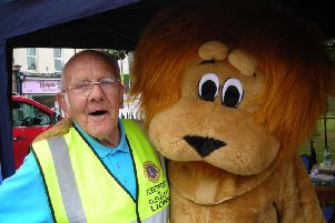 Pictured is Fleetwood and Cleveleys Lions veteran Denis Bowker with the Lions mascot (Brian Purcell), on Tram Sunday
