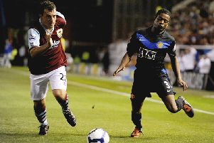 Burnley forward Robbie Blake is in pursuit of the ball alongside Manchester United's Patrice Evra at Turf Moor in 2009