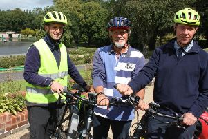 Coun. Emo (centre) with parks officer Sean Kerr (left) and head of greenspaces Simon Goff with one of the electric bikes at Thompson Park.