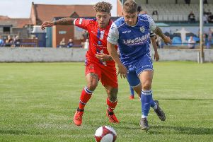 Frickley Athletic forward Jack McMenemy tussles with a Chasetown defender. Picture: Onion Bag Photos