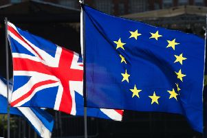 The Union and EU flags.