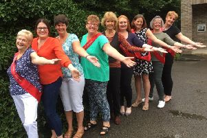 The slimmers from Pocklington, Market Weighton and Holme on Spalding Moor managed to lose more than 36 stone and earn the 'Woman of the Year' award.