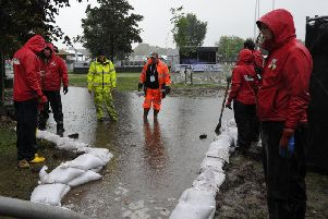 Staff trying to pump the floodwater out of the Fan Zone on the Stray in Harrogate which was closed on the final day due to flooding. (Picture Gerard Binks)